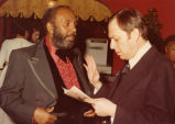 Charles B. Washington talking to Mike Albert