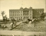 "Laying sidewalk to ""Old Main"""