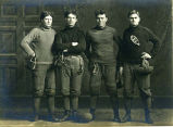 Four linemen of 1909 football team